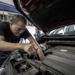 man performing basic car maintenance