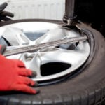 person doing tire rotation